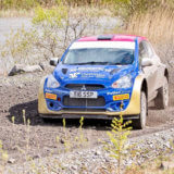 Rally car with the Oil 4 Wales logo on the bonnet